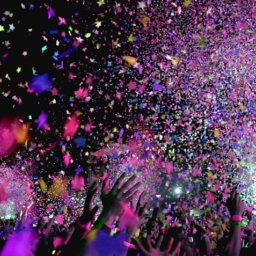 crowd at concert under confetti